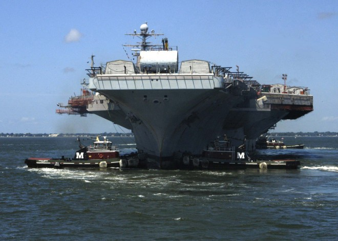 The aircraft carrier USS Theodore Roosevelt (CVN 71) departs Naval Station Norfolk and begins a towing operation to Northrop Grumman Newport News Ship Building for a Refueling Complex Overhaul (RCOH) in 2009. U.S. Navy Photo.