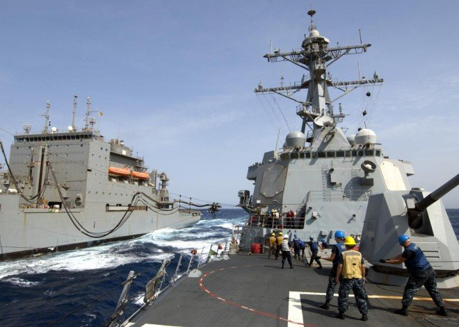 Sailors aboard the guided-missile destroyer USS James E. Williams (DDG 95) participate in a replenishment at sea on Sept. 7, 2012. U.S. Navy Photo