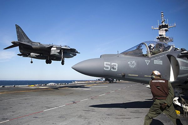 An AV-8B Harrier from Marine Medium Tiltrotor Squadron (VMM) 266 (Rein.) lands on the flight deck of the amphibious assault ship USS Kearsarge (LHD-3). US Navy Photo