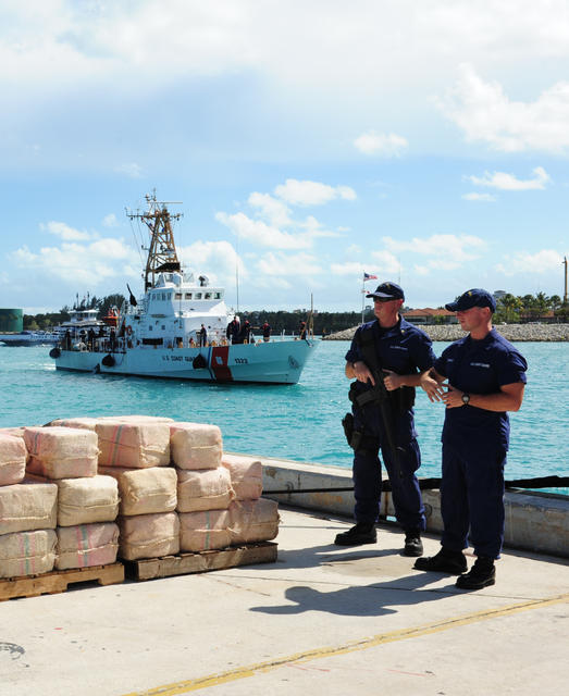 U.S. Coast Guardsmen unload 3,500 pounds of cocaine in Miami March 16, 2012. The crew seized the cocaine from a 35-foot vessel in the Caribbean Sea as part of Operation Martillo. US Coast Guard Photo