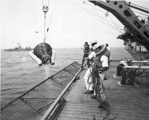 Sailors on the USS Wasp hoist Gemini 9A aboard, June 6, 1966. US Naval Institute Archives