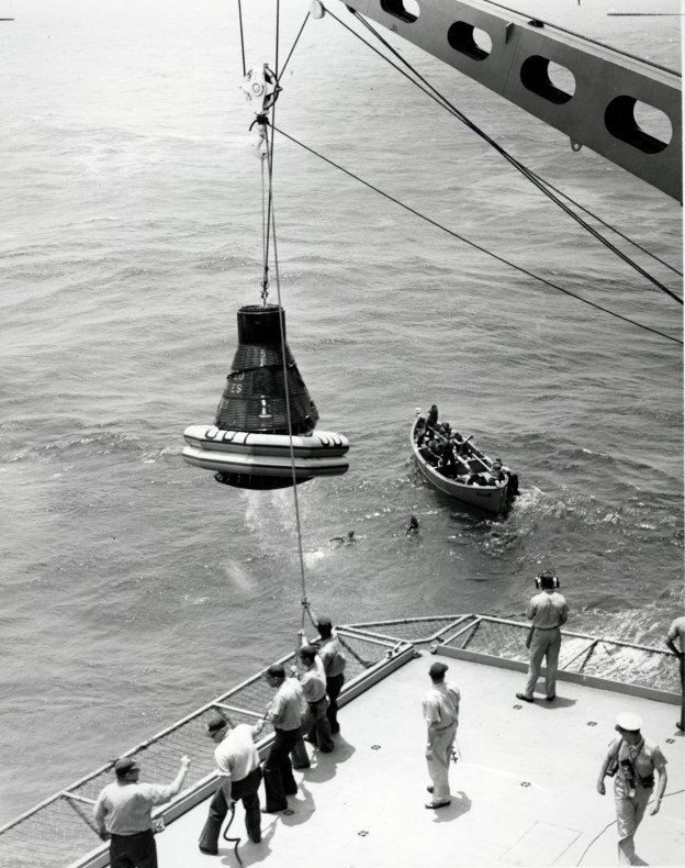 Faith 7 being hoisted out of the water by the USS Kearsarge, May 16, 1963. US Naval Institute Archives