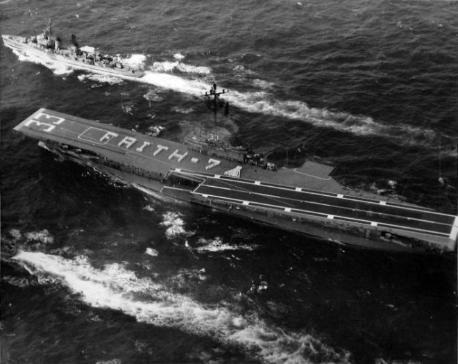 USS Kearsarge after recovering Faith 7. May 16, 1963. Note the formation of sailors in the shape of the capsule. US Naval Institute Archives