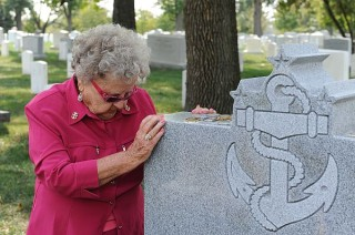 ima Black, widow of the first Master Chief Petty Officer of the Navy , Delbert Black, visits the grave of her late husband on Sept. 27. US Navy Photo