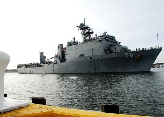 USS Carter Hall (LSD 50) pulls away from Joint Expeditionary Base Little Creek-Fort Story on March, 11 2013. US Navy Photo