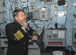 Adm. Bill Gortney, commander of U.S. Fleet Forces Command, addresses the crew aboard the aircraft carrier USS Dwight D. Eisenhower (CVN-69) on Feb. 21. US Navy Photo