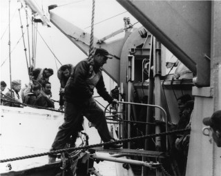 Capt. F.A. Andrews, USN, Search Commander, coming off of USS Fort Snelling (LSD 30). Naval Institute Archives