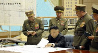 Undated picture of North Korean leader Kim Jong Un and his advisors.