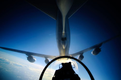 A U.S. Air Force KC-135 Stratotanker refuels an F-16 Fighting Falcon over the Pacific Ocean in 2012. US Air Force Photo