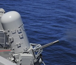 A MK 15 Phalanx close-in weapons system (CIWS) is test fired on the flight deck aboard the aircraft carrier USS Carl Vinson (CVN-70). US Navy Photo