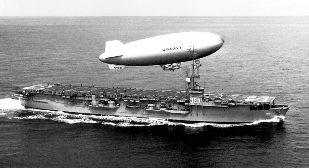 US Navy rigid airship K-69 over USS Mindoro in 1950. US Navy Photo