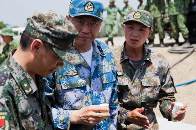 People's Liberation Army Navy Rear Adm. Kan Li Kui drinks a sample of purified water at a disaster site in Biang, Brunei Darussalam June 19, as part of the Association of Southeast Asian Nations Humanitarian Assistance/Disaster Relief and Military Medicine Exercise. US Marine Corps Photo.