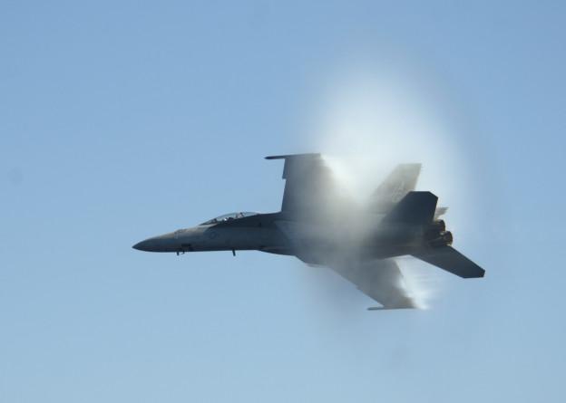 An F/A-18F Super Hornet flies from USS Dwight D. Eisenhower (CVN 69). US Navy Photo.