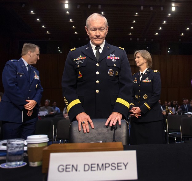 Chairman of the Joint Chiefs of Staff General Martin E. Dempsey waits to be seated during the Senate Armed Services Committee reconfirmation hearing on July 18, 2013. Department of Defense Photo