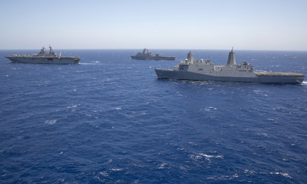 USS Kearsarge (LHD-3), left, leads the amphibious dock landing ship USS Carter Hall (LSD-50) and the amphibious transport dock ship USS San Antonio (LPD-17) on June 16, 2013. US Navy Photo