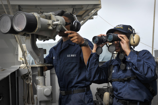 Seaman Apprentice Robert Nunez, left, from Suffolk, Va., and Seaman Apprentice Amy M. Haskins, from Kansas City, Mo., stand watch on the signal bridge aboard the aircraft carrier USS Nimitz (CVN-68). US Navy Photo