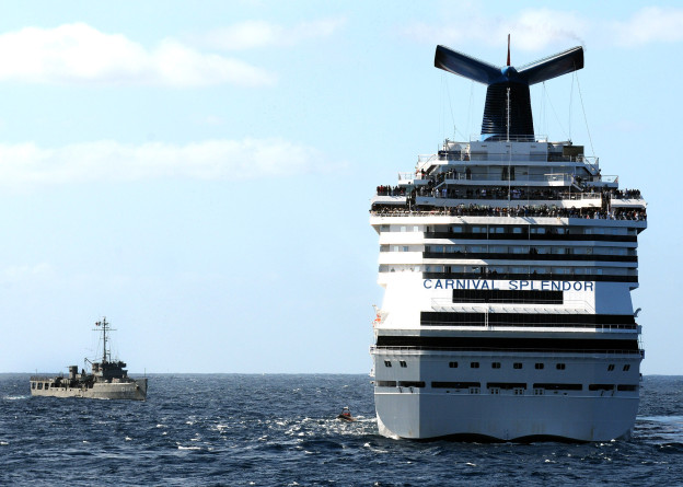 C/V Carnival Splendor along side a Mexican Navy ship in 2010. US Navy Photo
