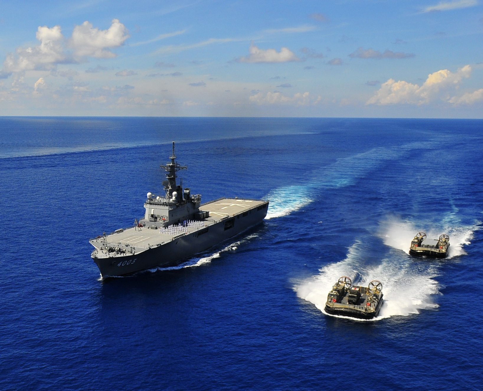 Osumi-class amphibious assault ship JDS Kunisaki (LST 4003), center, and two landing craft air cushions assigned to Kunisaki in 2010. US Navy Photo