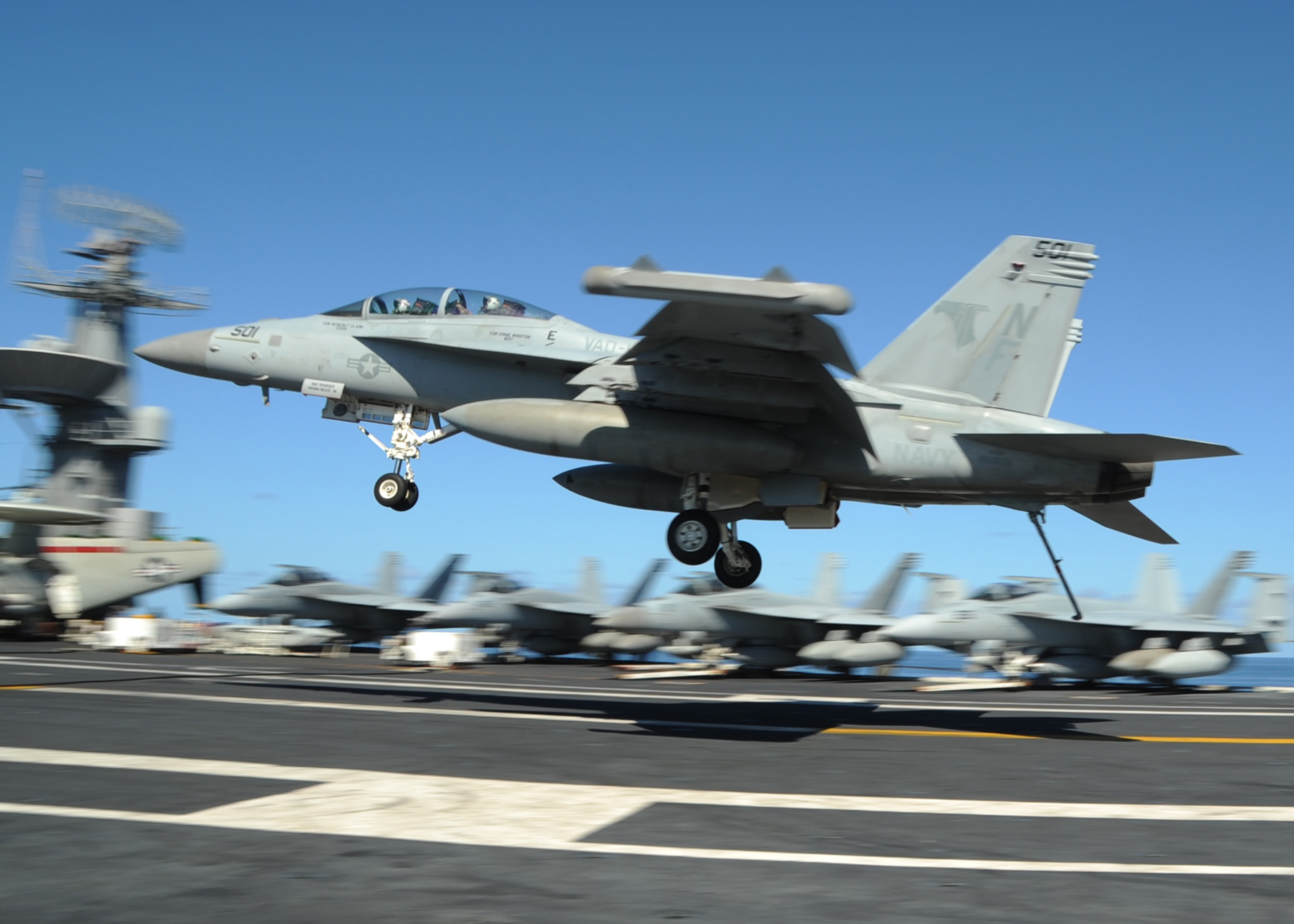 "An EA-18G Growler from the ""Shadowhawks"" of Electronic Attack Squadron (VAQ) 141 prepares to make an arrested landing on the flight deck of the U.S. Navy's forward-deployed aircraft carrier USS George Washington (CVN-73) during a 2013 exercise with the Australian Defence Force. US Navy Photo"