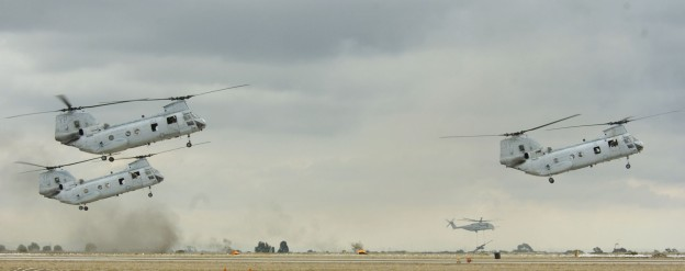Three U.S. Marine Corps CH-46E Sea Knight helicopters, assigned to Marine Medium Helicopter Squadron One Six Six (HMM-163) provides support during the Air show's Marine Air-ground Task Force (MAGTF) demonstration in 2005.