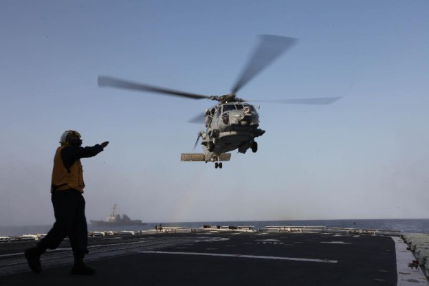 A U.S. Navy MH-60 lands on the Chinese Navy ship Harbin.