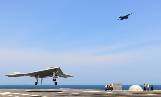 X-47B Unmanned Combat Air System (UCAS) demonstrator completes an arrested landing on the flight deck of the aircraft carrier USS George H.W. Bush (CVN-77). US Navy Photo