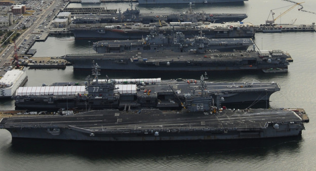USS Dwight D. Eisenhower (CVN-69), USS George H.W. Bush (CVN-77), USS Enterprise (CVN-65), USS Harry S. Truman (CVN-75), and USS Abraham Lincoln (CVN-72) are in port at Naval Station Norfolk, Va. in 2012.