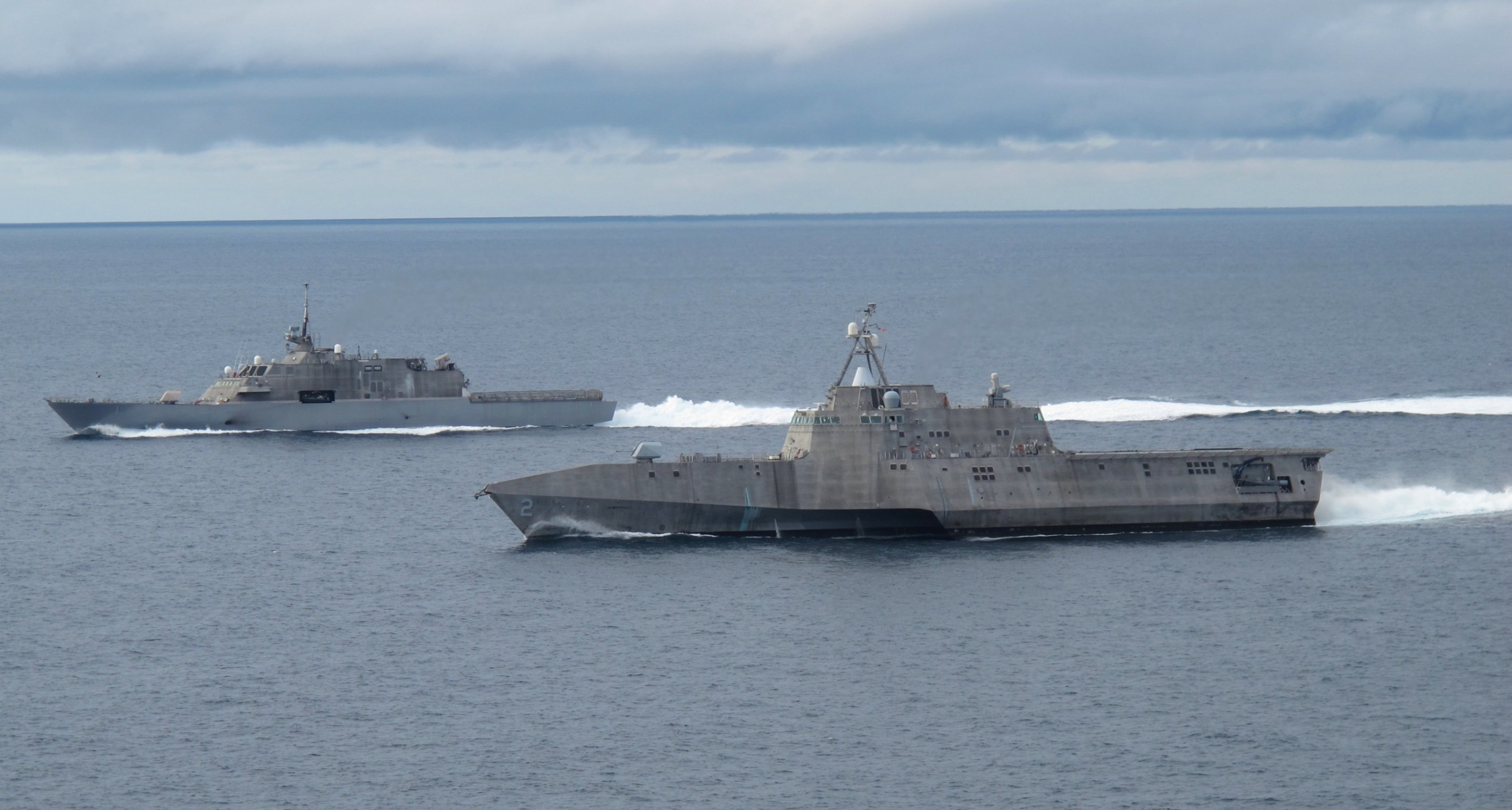 USS Freedom (LCS-1), left, and USS Independence (LCS-2) in 2012. US Navy Photo