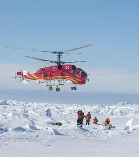 Chinese helicopter rescuing stranded researchers and tourists. Australian Maritime Safety Authority Photo