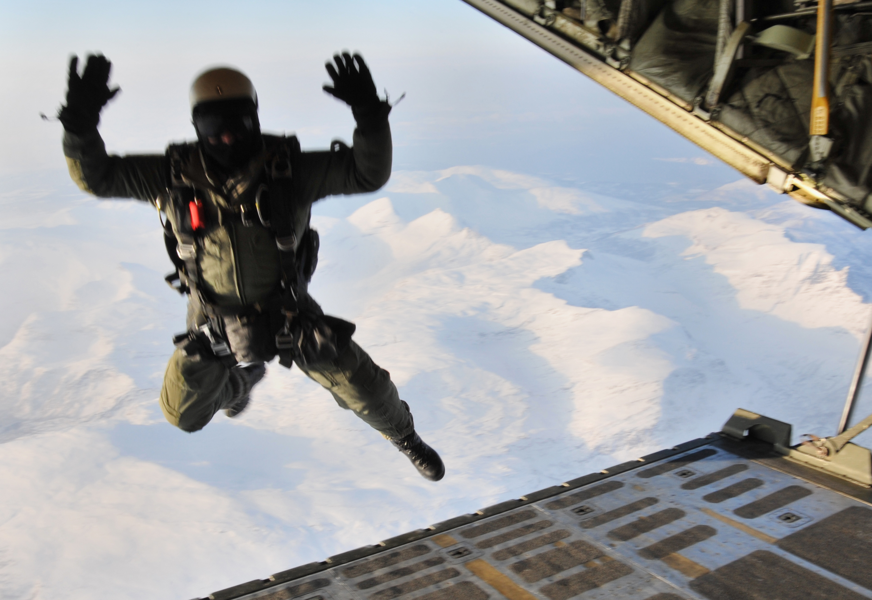 A Navy SEAL freefalls from an Austrian C-130 aircraft above the Arctic Circle in 2010. US Navy Photo