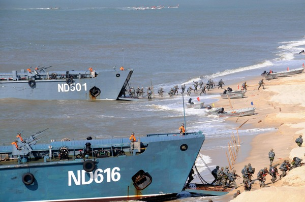 Chinese marines assault a beach during the Mission Action 2013 exercise. Xinhua Photo