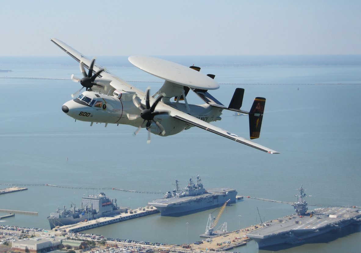 An E-2D Hawkeye assigned to the Tiger Tails of Carrier Airborne Early Warning Squadron (VAW) 125 flies over Naval Station Norfolk on March 20, 2014.