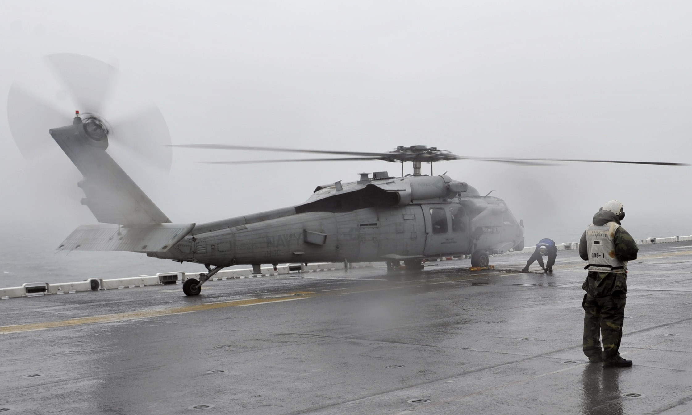 An MH-60S Sea Hawk helicopter assigned to Helicopter Sea Combat Squadron (HSC) 25 is chained to the deck after landing on the flight deck of the forward-deployed amphibious assault ship USS Bonhomme Richard (LHD 6) after conducting search and rescue operations. Sailors and Marines onboard Bonhomme Richard are conducting search and rescue operations as requested by the Republic of Korea. US Navy Photo
