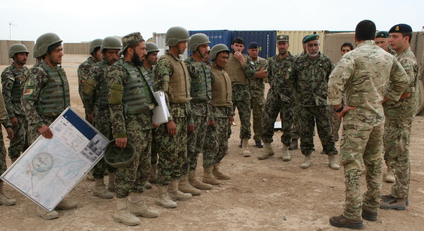 Afghan National Army soldiers with the 215th Corps stand in formation as they receive a brief on May 7, 2014. US Marine Corps Photo