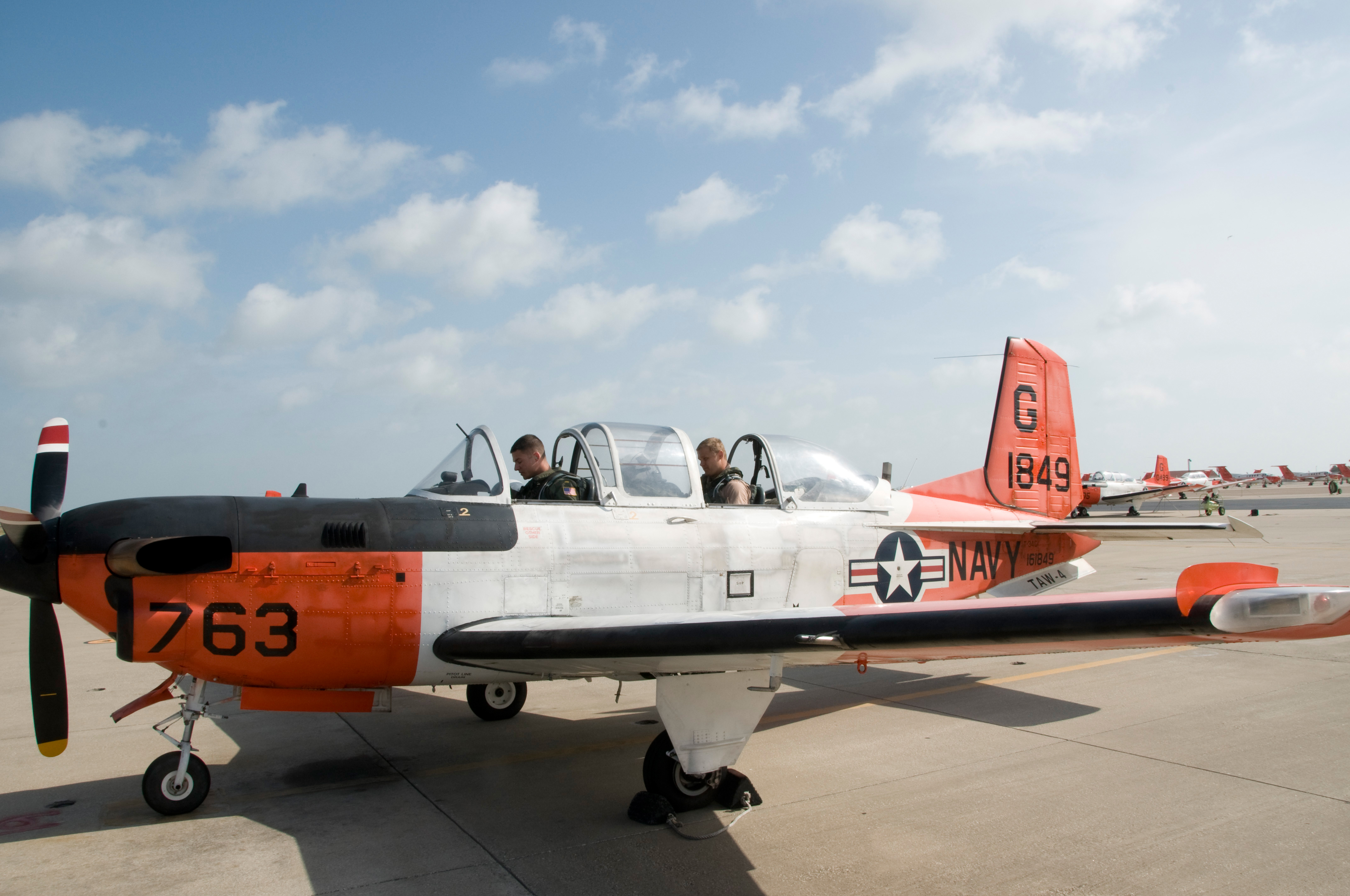 Two sailors in a T-34C Turbomentor before a training flight. US Navy Photo