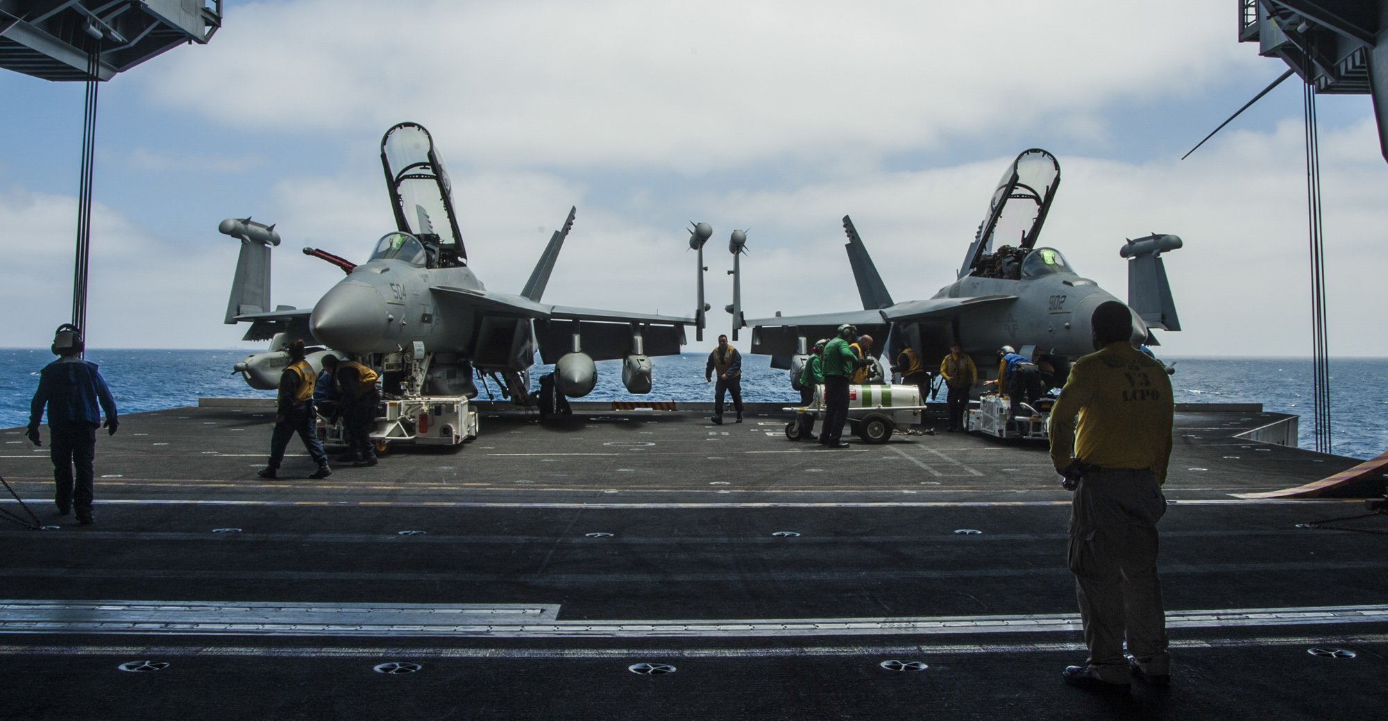 Two EA-18G Growlers assigned to the Cougars of Electronic Attack Squadron (VAQ) 139 to the flight deck. on USS Carl Vinson (CVN-70) on May 31, 2014. US Navy Photo