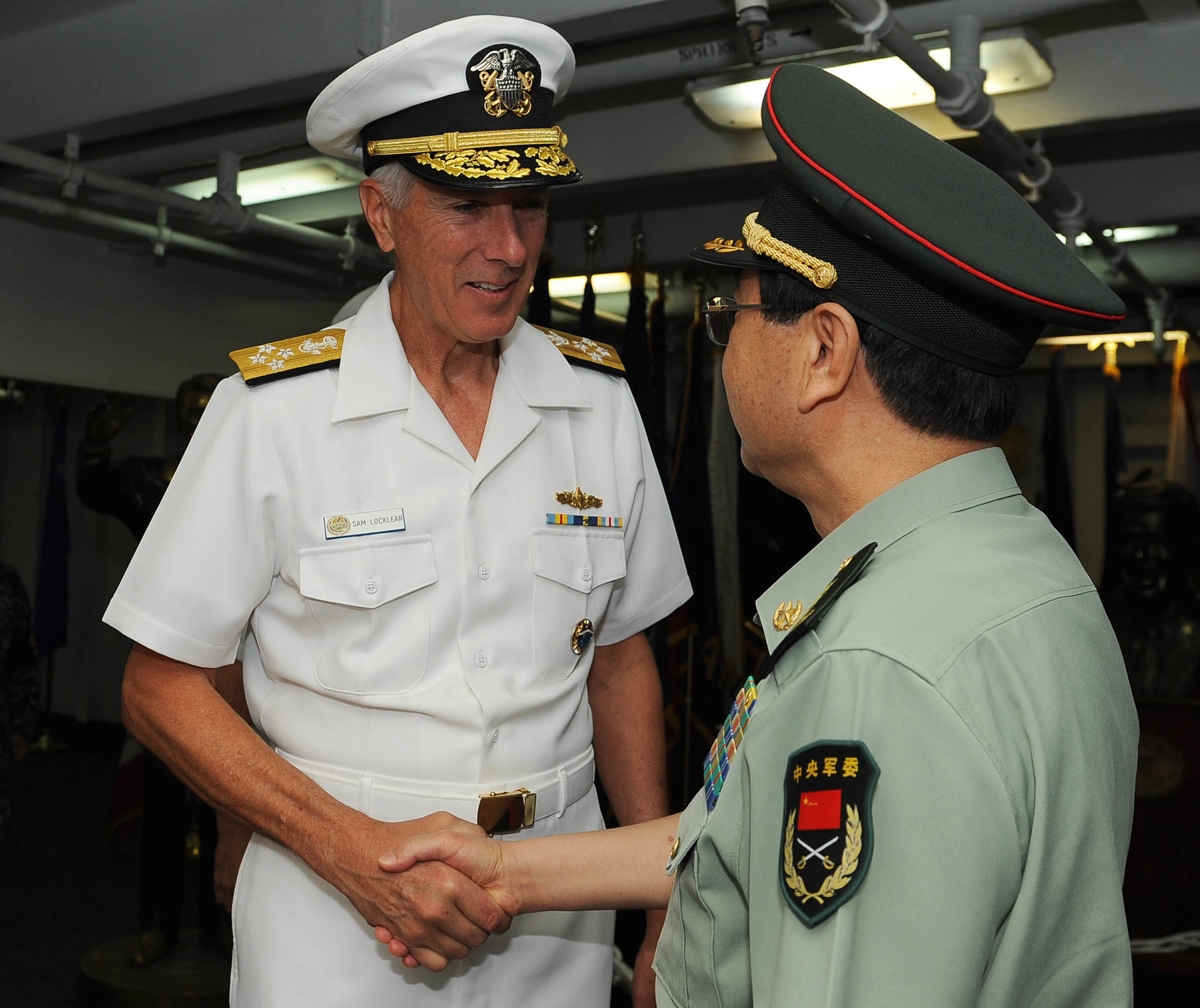 Adm. Samuel J. Locklear, commander of U.S. Pacific Command, greets Chief of the General Staff of the People's Republic of China Gen. Fang Fenghui aboard the aircraft carrier USS Ronald Reagan (CVN-76) on May 13, 2014. US Navy Photo
