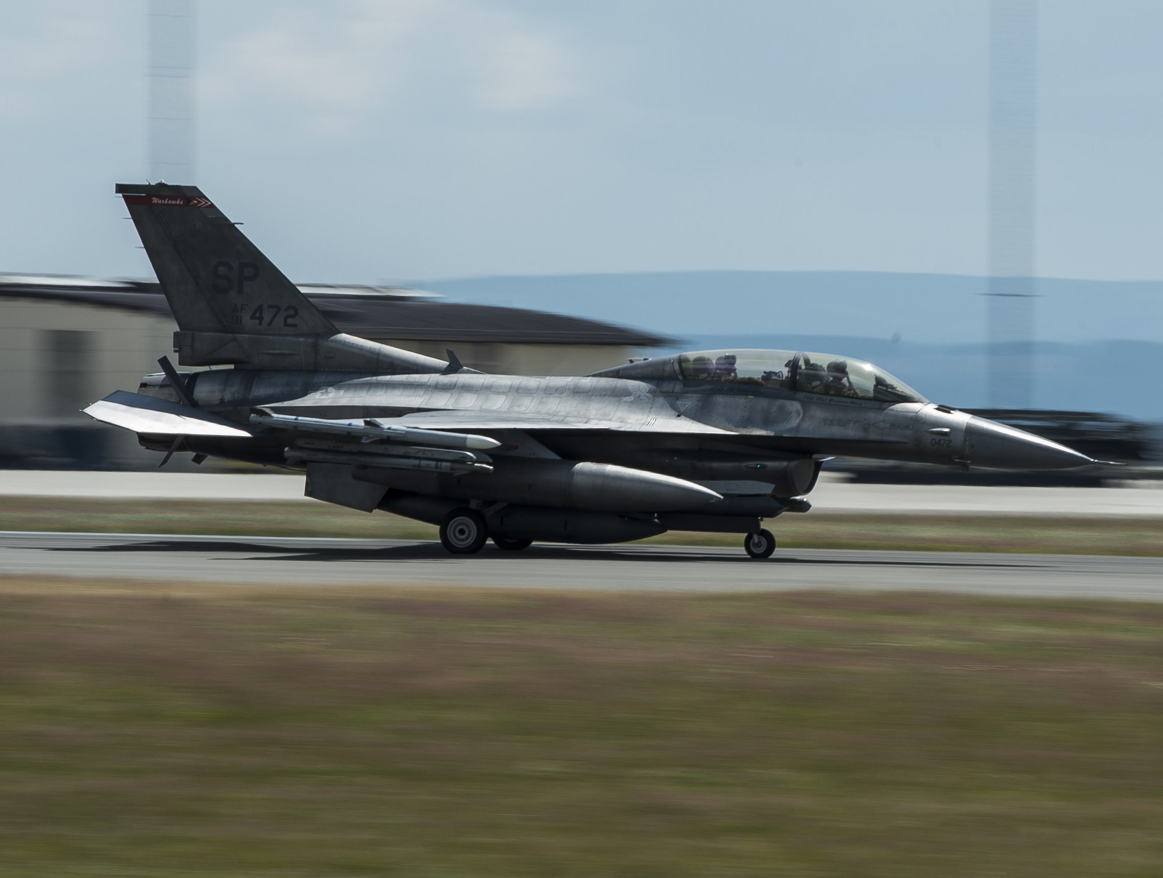 A two-seat F-16 Fighting Falcon lands June 30, 2014, on Spangdahlem Air Base, Germany. USAF Photo