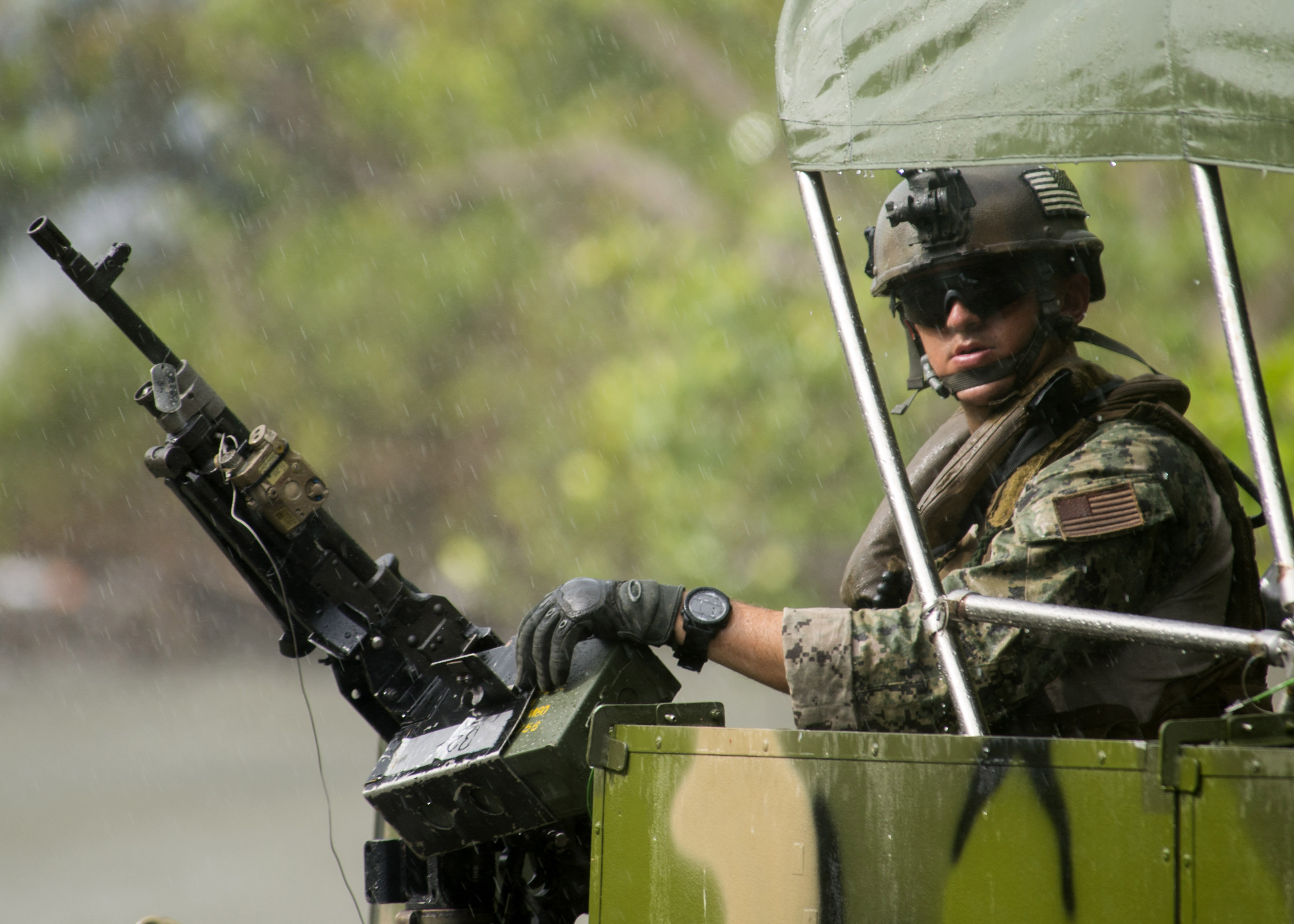 A member of Coastal Riverine Squadron (CORIVRON) 2, conducts interdict ion training with the Belize Special Boat Unit. US Navy Photo