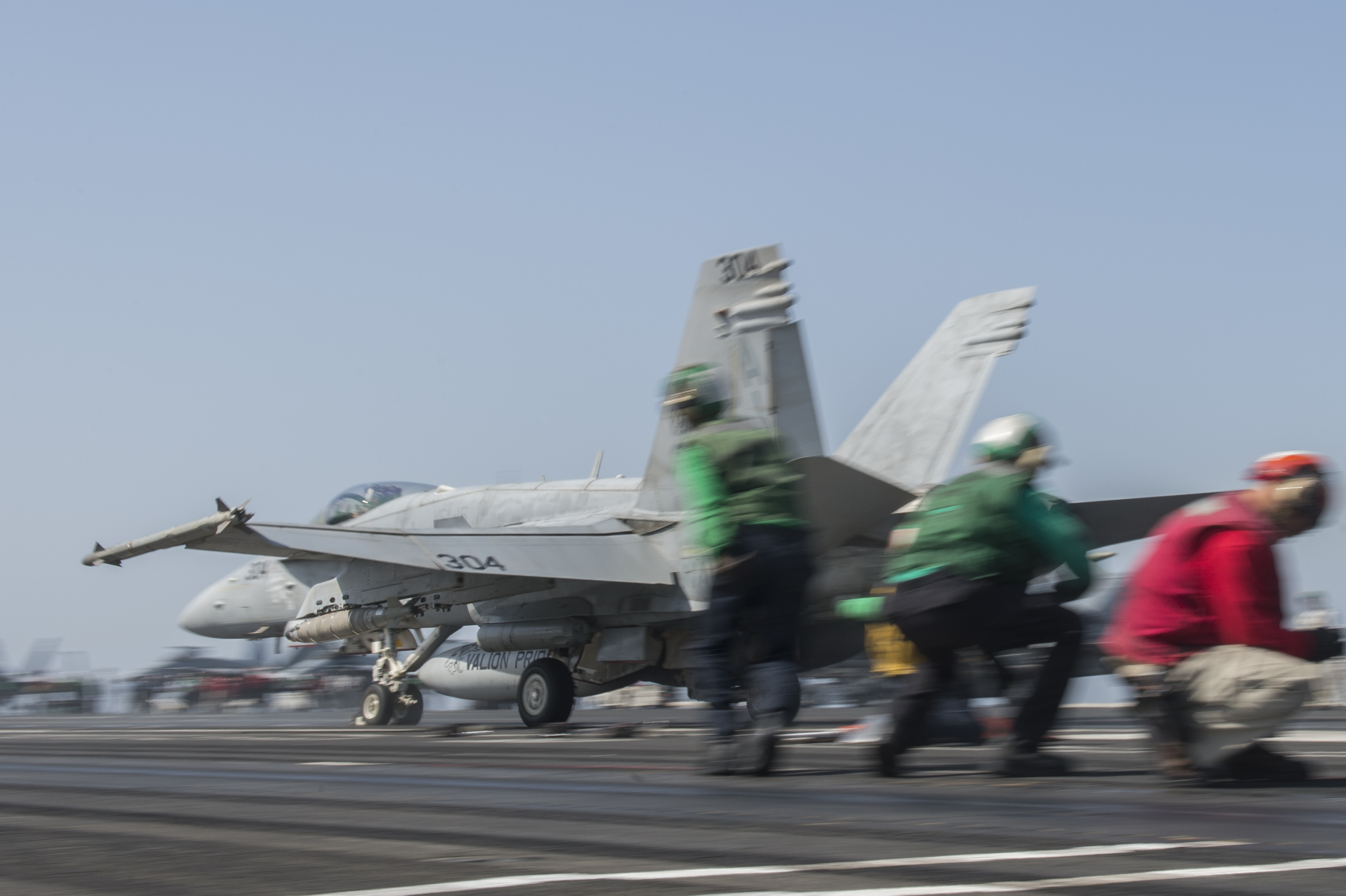 An F/A-18C Hornet attached to the Valions of Strike Fighter Squadron (VFA) 15 launches from the flight deck of the aircraft carrier USS George H.W. Bush (CVN 77) on Aug. 11, 2014. US Navy Photo