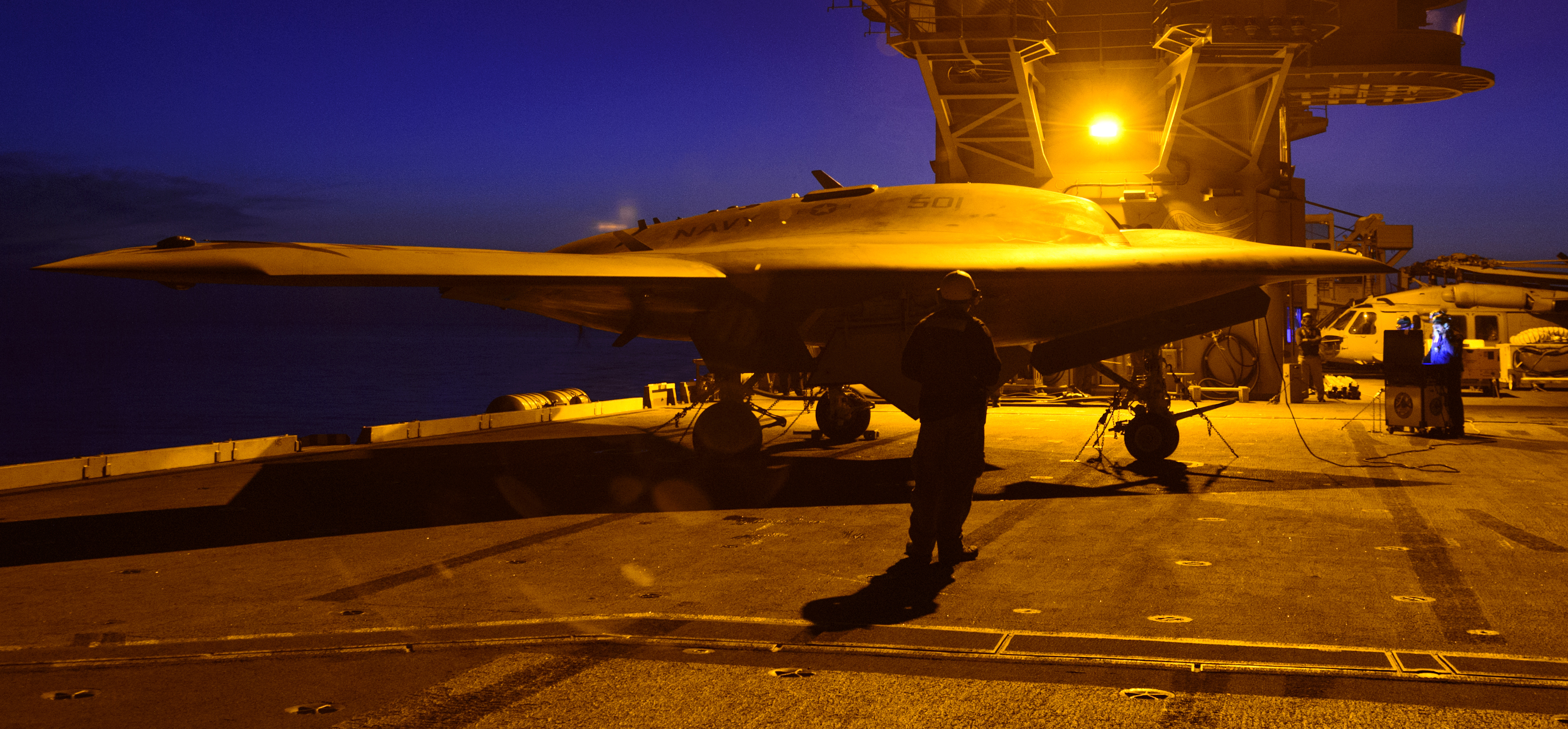 Navy's unmanned X-47B conducts night flight operations aboard the aircraft carrier USS Theodore Roosevelt (CVN-71) on Aug. 21, 2014. US Navy Photo
