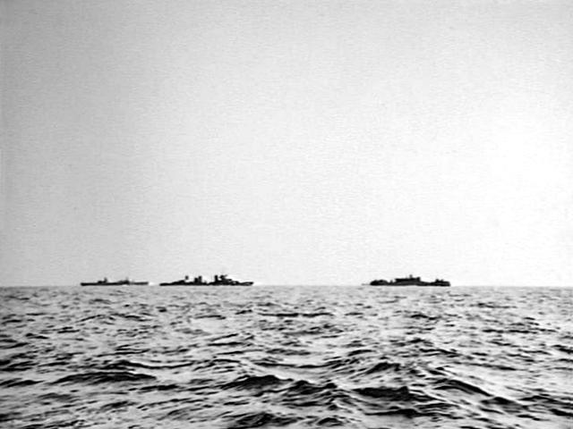 USS Houston (CA-30) escorts merchant ships in the Timor Sea, in February 1942. The photo was takten from the Australian Grimsby-class corvette HMAS Swan (U74). Australian War Memorial Photo