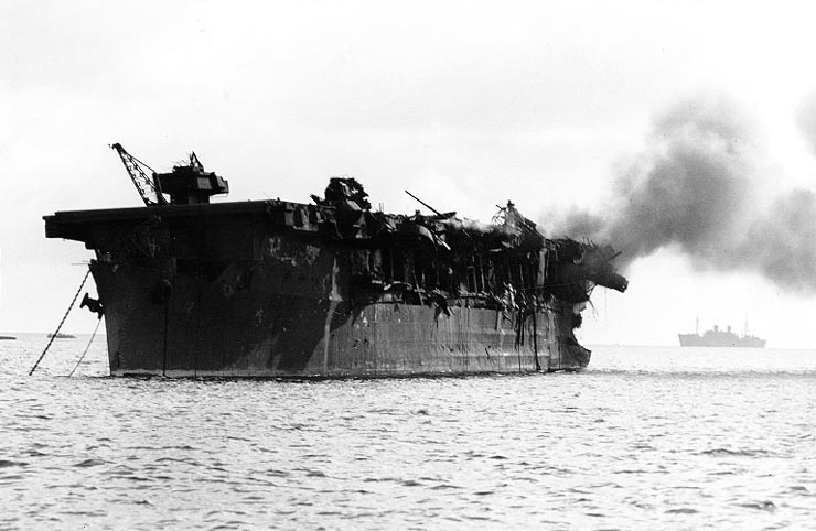 "USS Independence (CVL-22) afire aft, soon after the ""Able Day"" atomic bomb air burst test at Bikini on July 1, 1946."