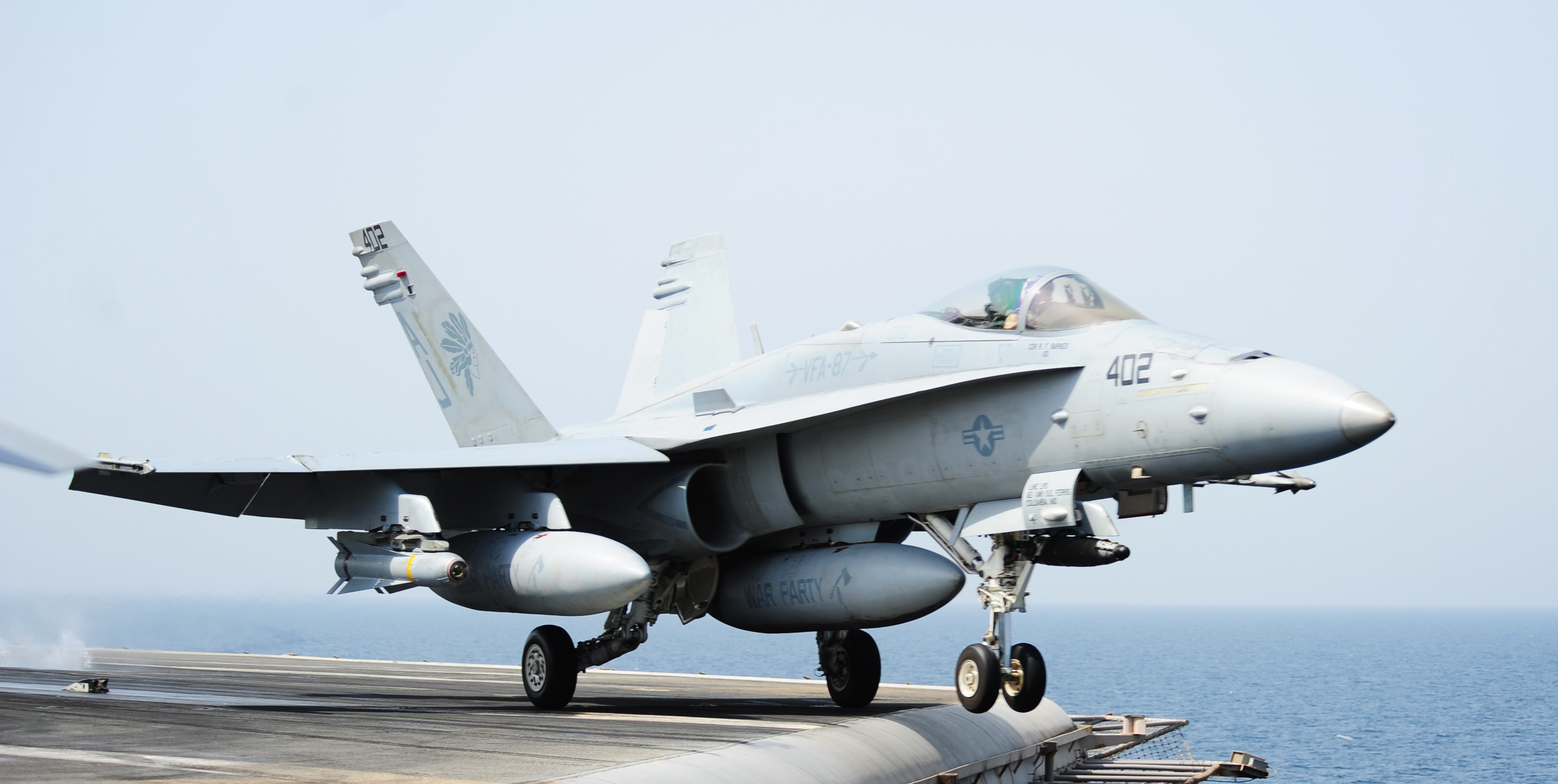 An F/A-18C Hornet attached to the Golden Warriors of Strike Fighter Squadron (VFA) 87 launches from the flight deck of the aircraft carrier USS George H.W. Bush (CVN-77) on July 26, 2014. US Navy Photo