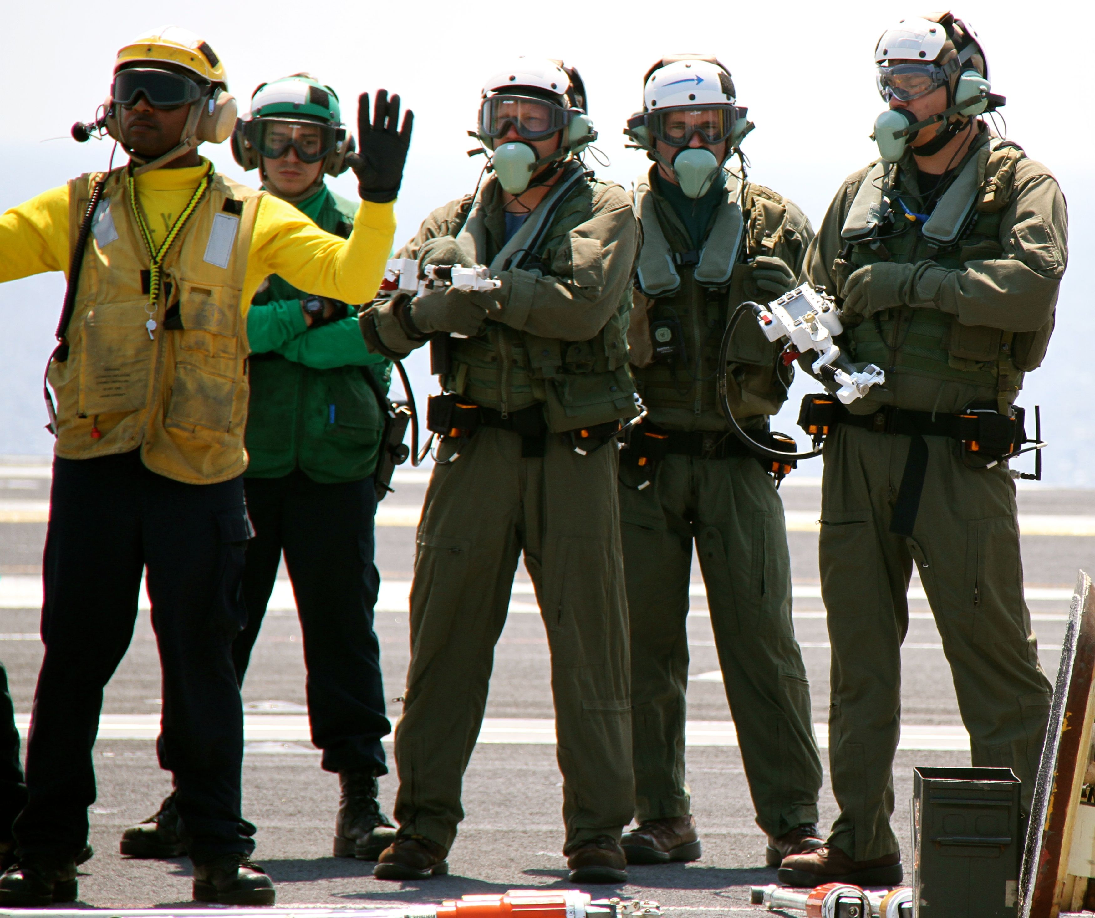 Contractors with Northrop Grumman responsible for operating the X-47B on the deck of USS Theodore Roosevelt (CVN-71) on Aug. 17, 2014. US Naval Institute Photo