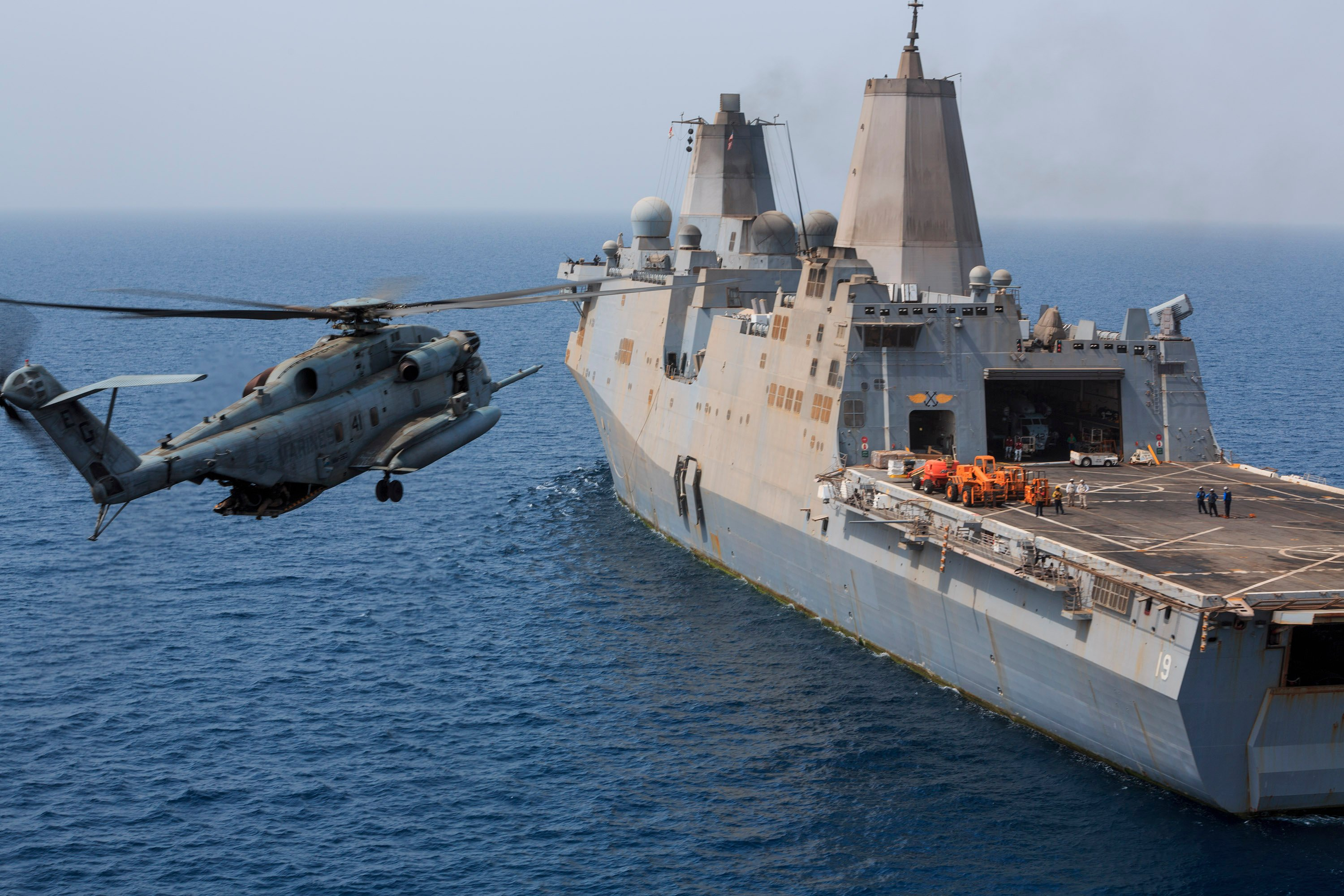 U.S. Marine Corps CH-53E Super Stallion helicopter with Marine Medium Tiltrotor Squadron (VMM) 263 (Reinforced), 22nd Marine Expeditionary Unit (MEU), prepares to land aboard the amphibious transport dock ship USS the Mesa Verde (LPD-19) on Aug. 4, 2014. US Navy Photo