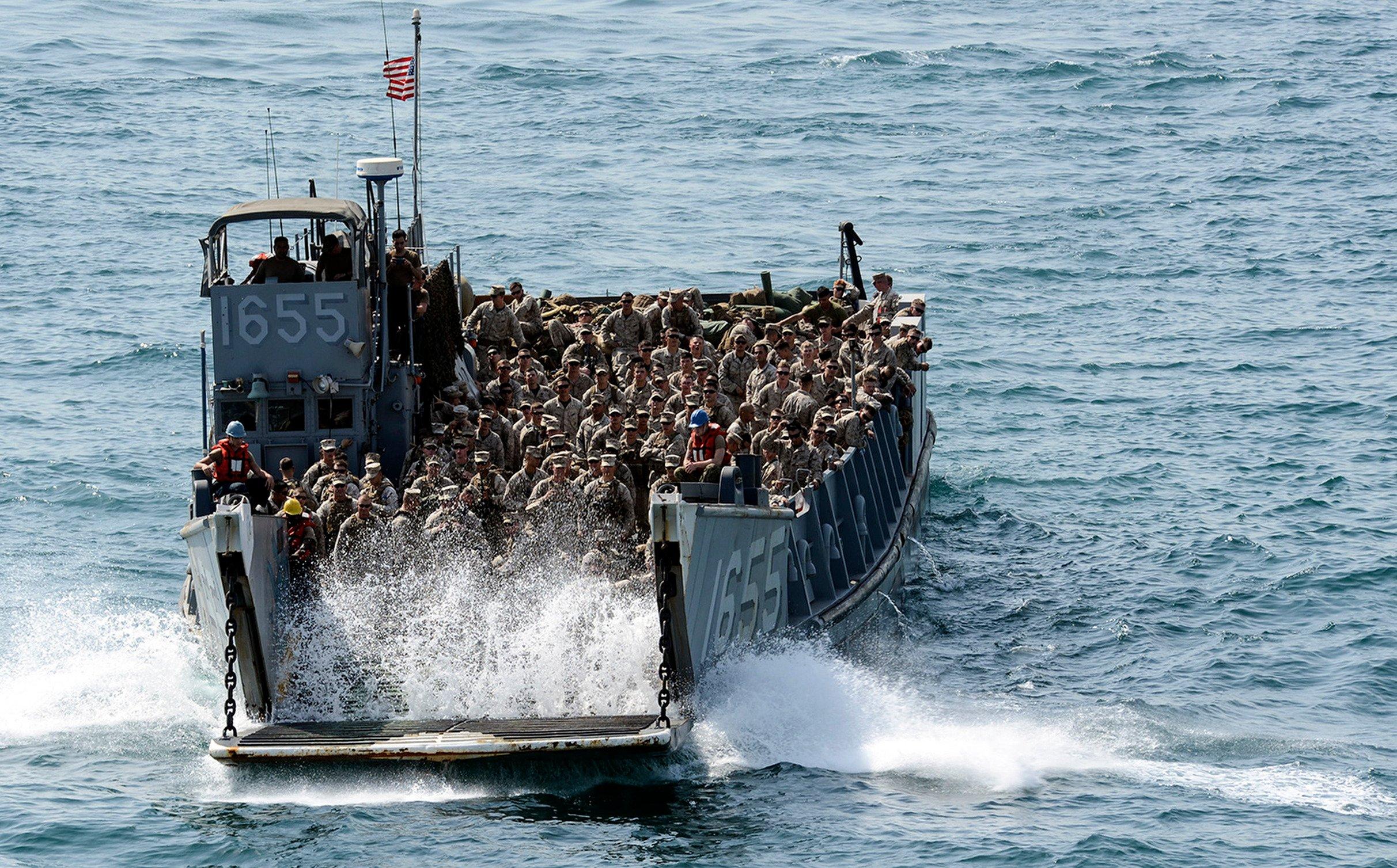 Marines aboard Landing Craft Utility (LCU) 1655 approach the well deck of the amphibious assault ship USS Bataan (LHD-5) on Aug. 22, 2014. US Navy Photo