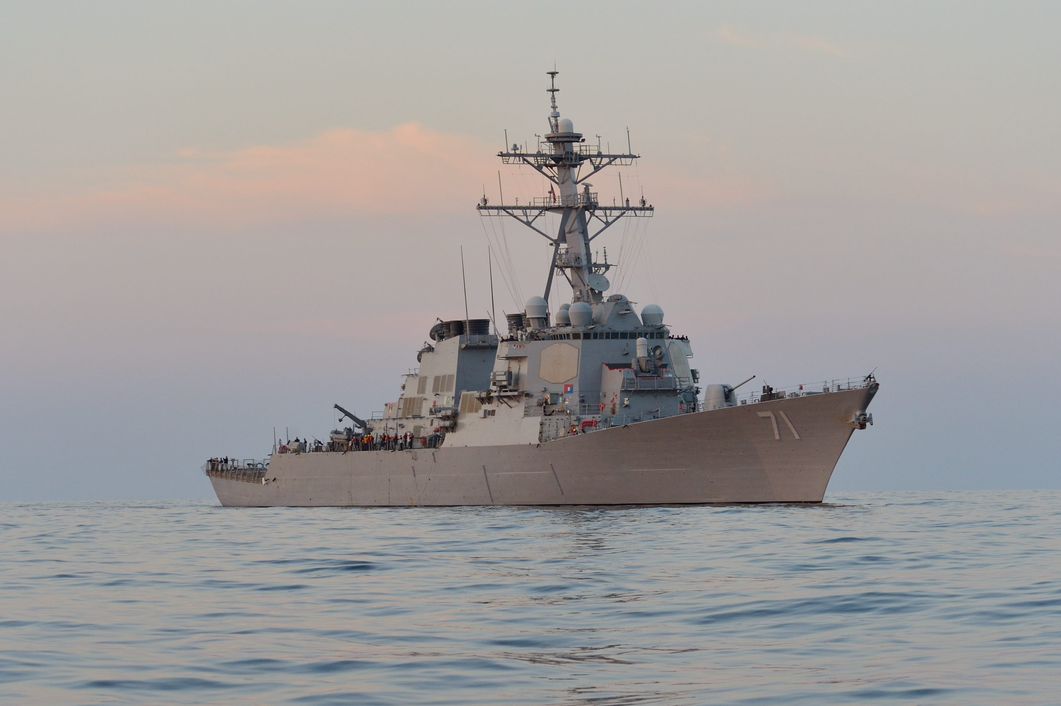 USS Ross (DDG 71) stands by during a nighttime passenger transfer during exercise Sea Breeze 2014 on Sept. 9, 2014. US Navy Photo