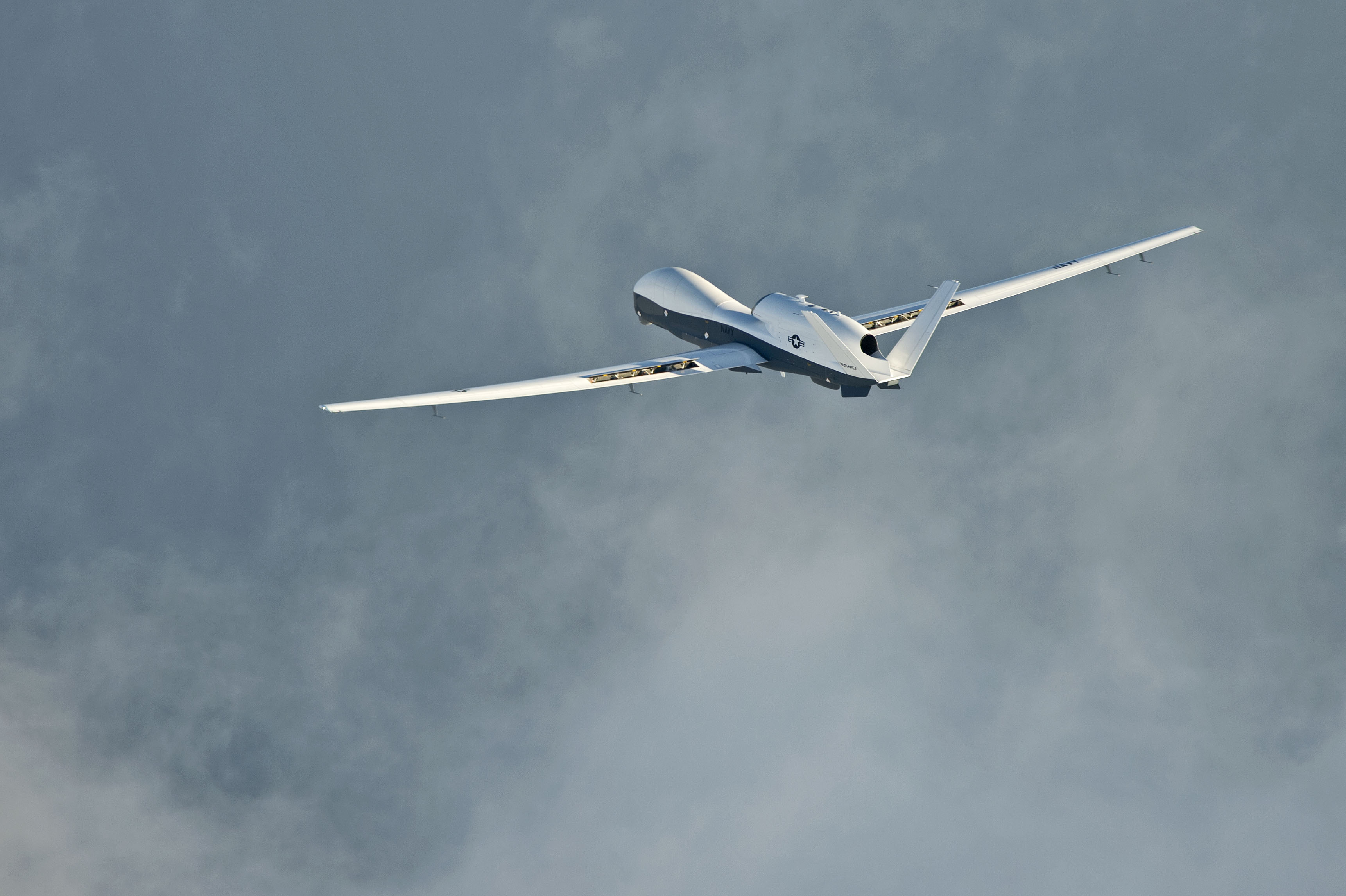 MQ-4C Triton unmanned aircraft system completes its inaugural cross-country ferry flight at Naval Air Station Patuxent River, Md. on Sept. 18, 2014. US Navy Photo