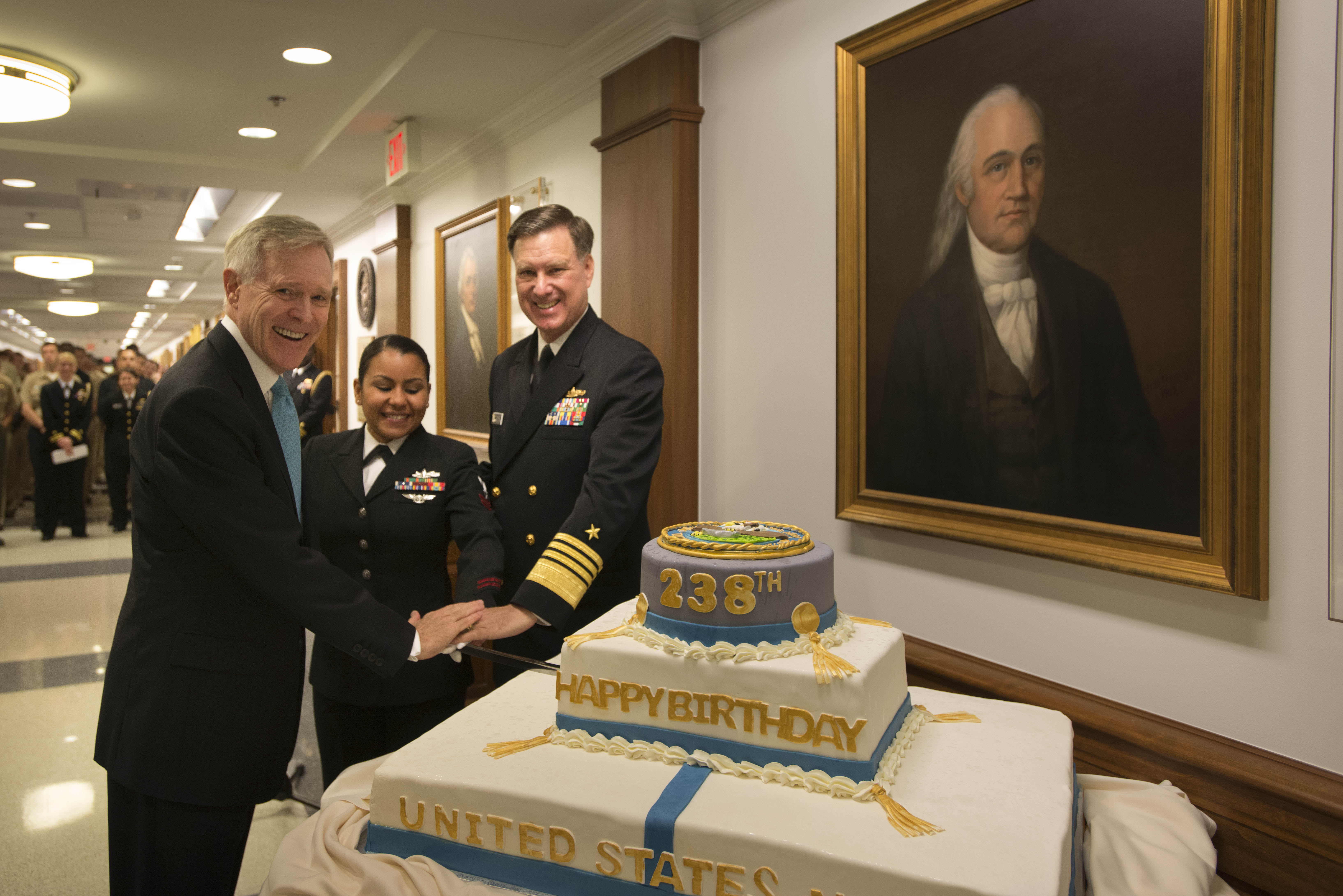 Secretary of the Navy (SECNAV) Ray Mabus, left, Yeoman 2nd Class Kritzia Pontier and Vice Chief of Naval Operations (VCNO) Adm. Mark Ferguson, cut a cake to celebrate the 238th birthday of the Navy. US Navy Photo